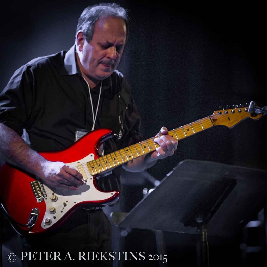 Al Orlo with red guitar