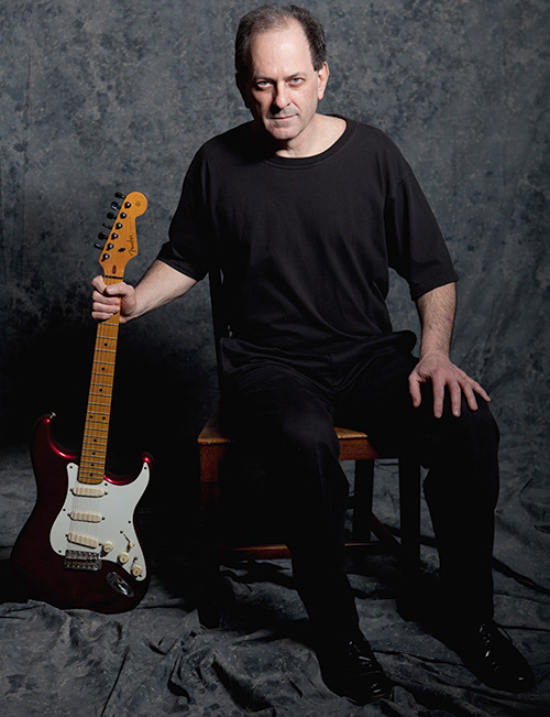 Al with guitar
